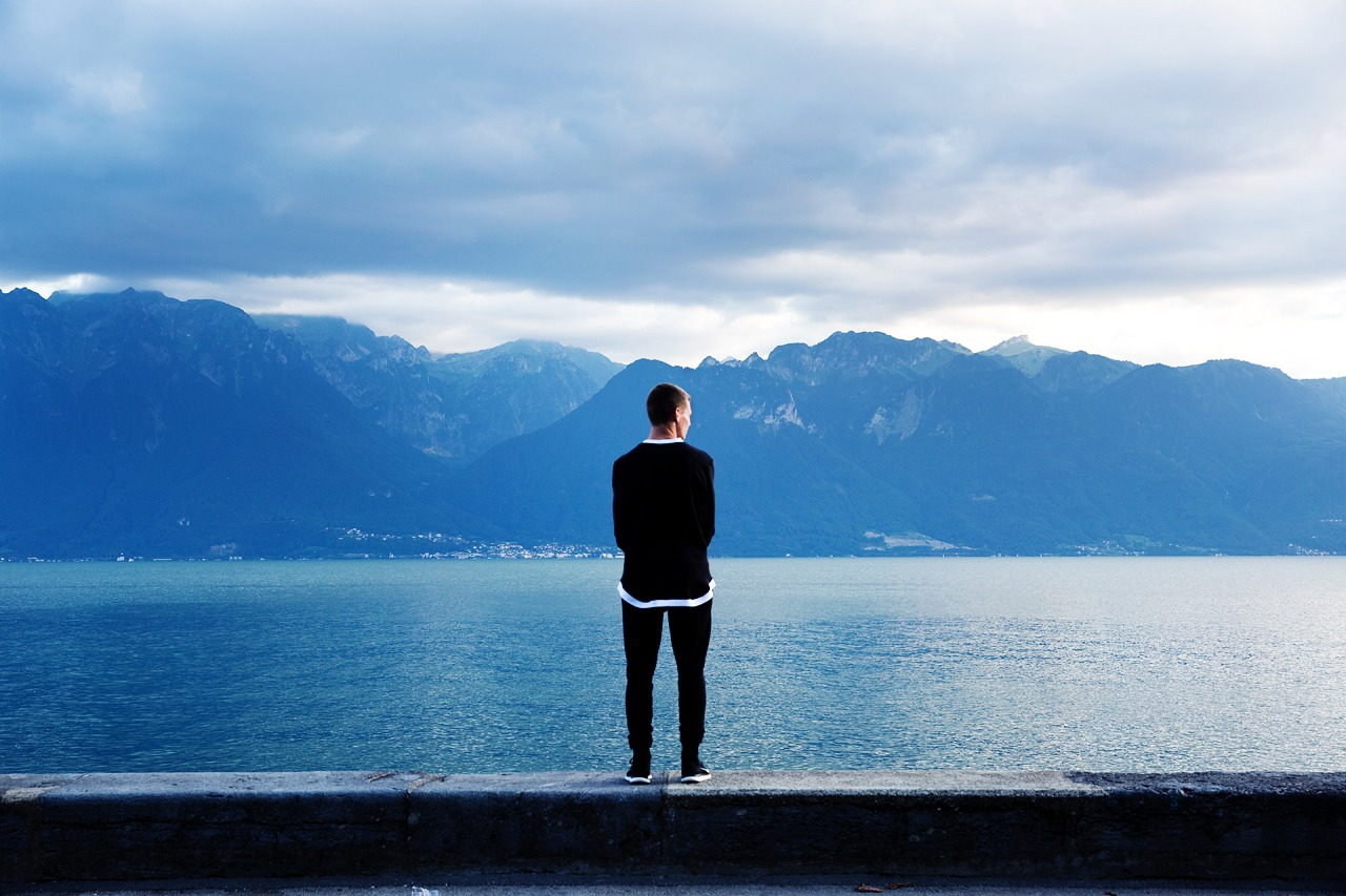man looking at lake