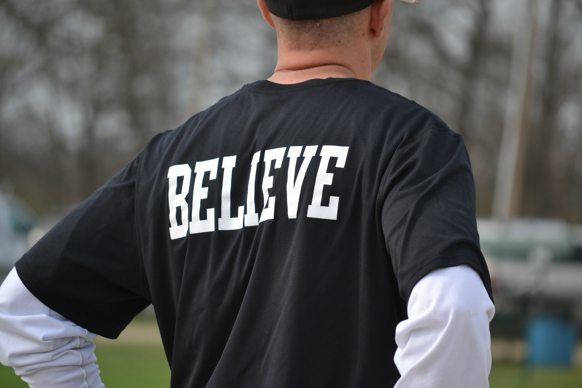"""Person with a shirt saying """"Believe"""". Believe that a alcohol free life is possible"""