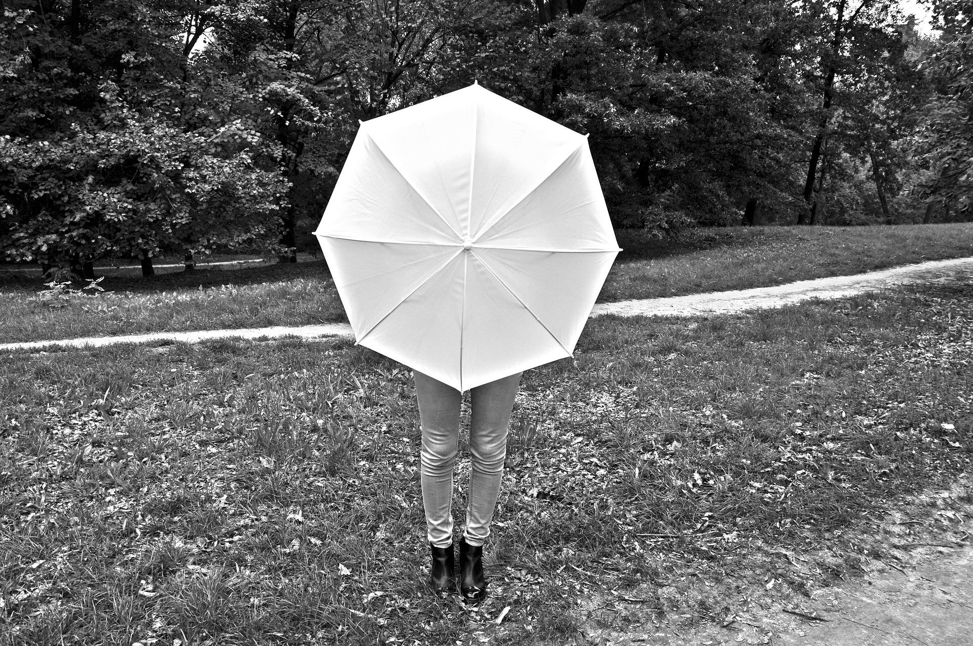 person with umbrella, related with sober living