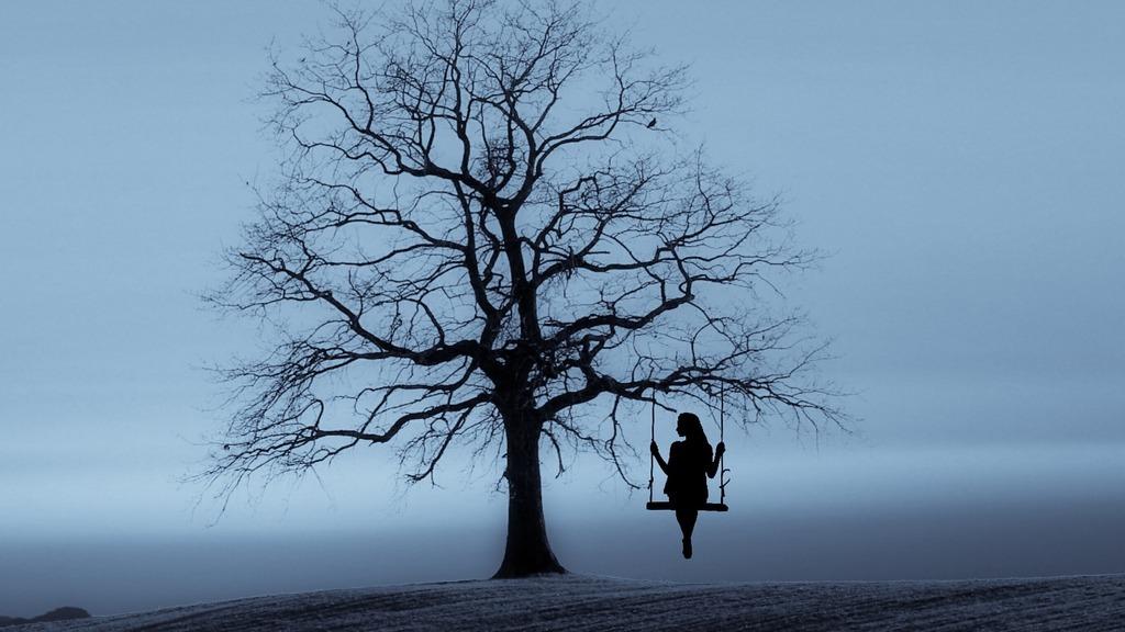 woman on swing in Tree