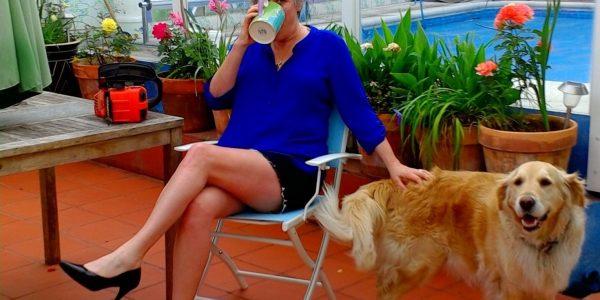 Woman chainsaw dog garden