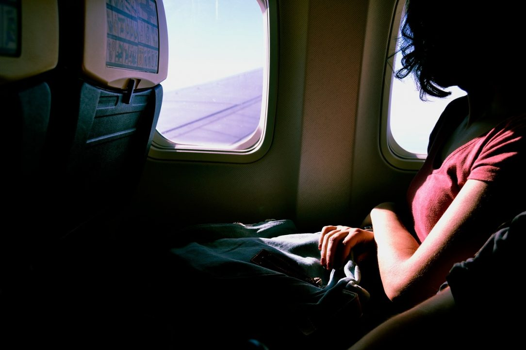 Woman on Airplane Alcohol Free