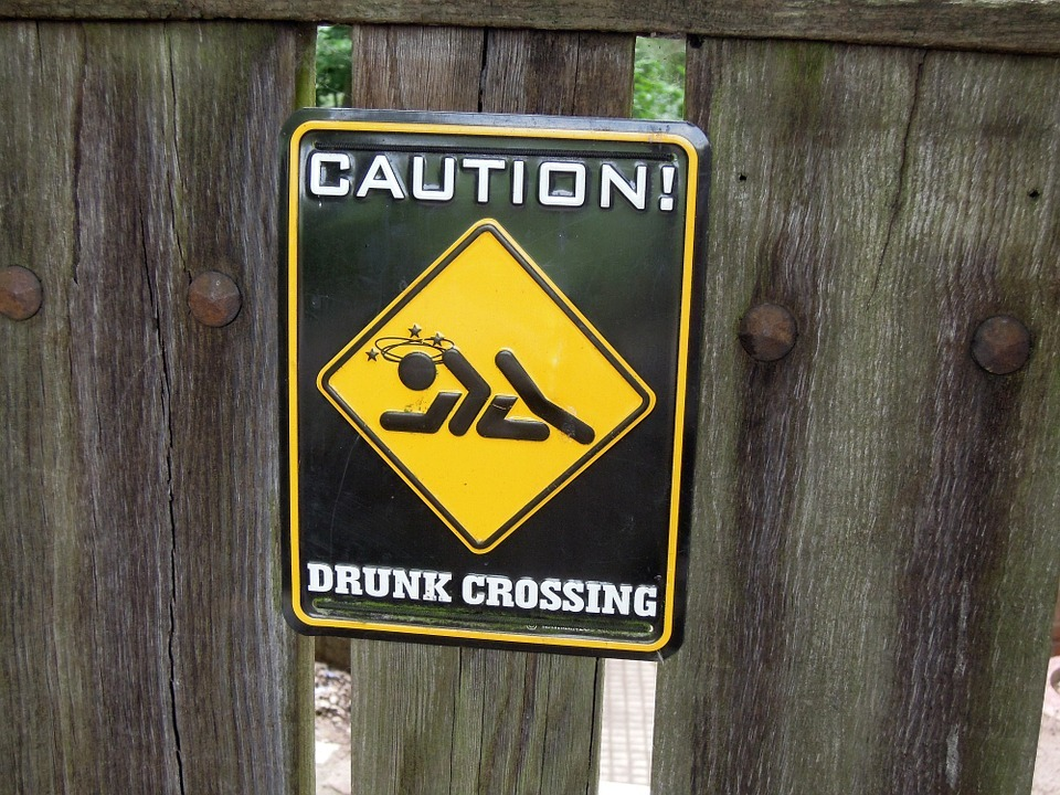 Caution Drunk Crossing sign - stop drinking Life or death - sober