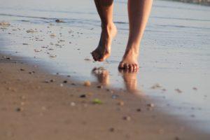 person on beach - Boom community