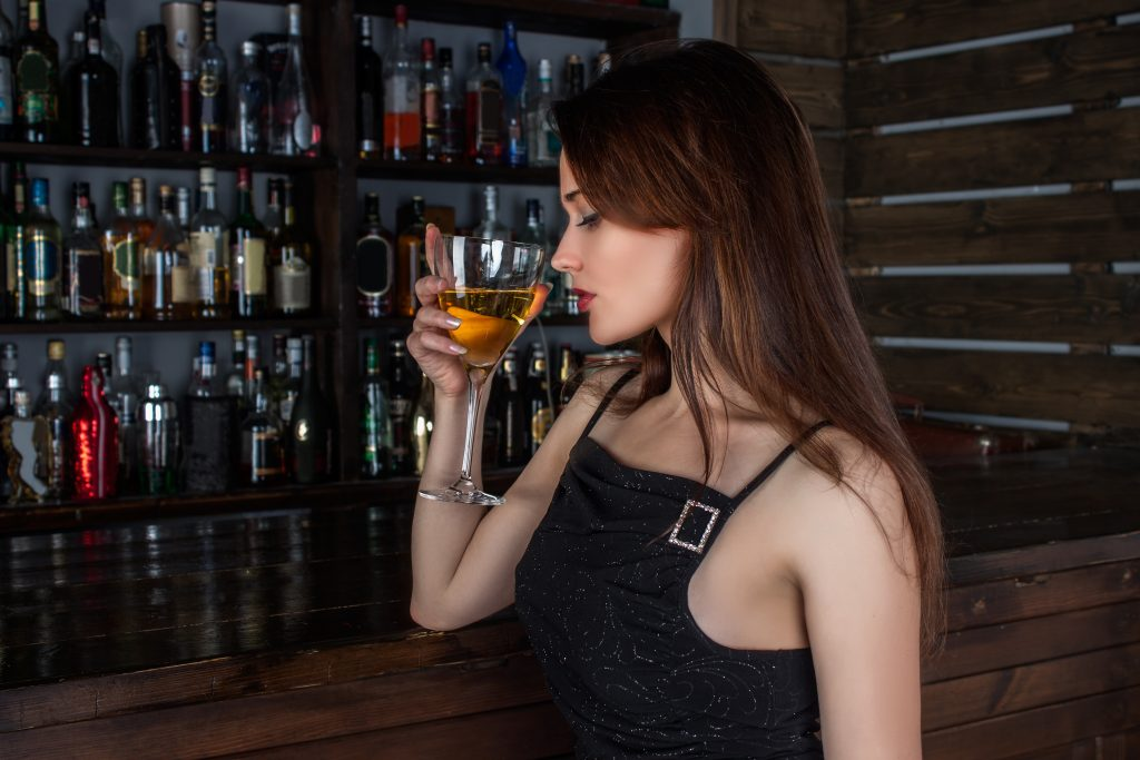 Glamorous and cool woman drinking wine