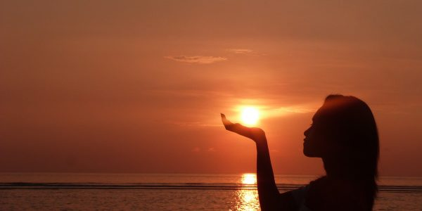 Woman holding Sun