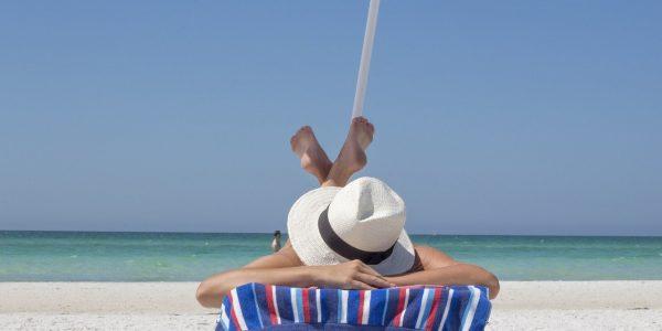 Alcohol Free Vacation woman sunbathing on the Beach