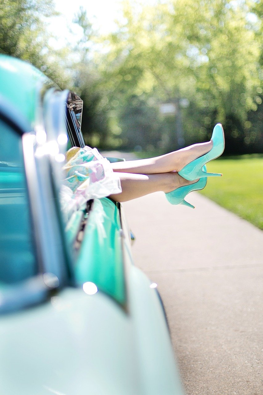 Woman's feet in High heeled shoes sticking out car window- alcohol FREE !