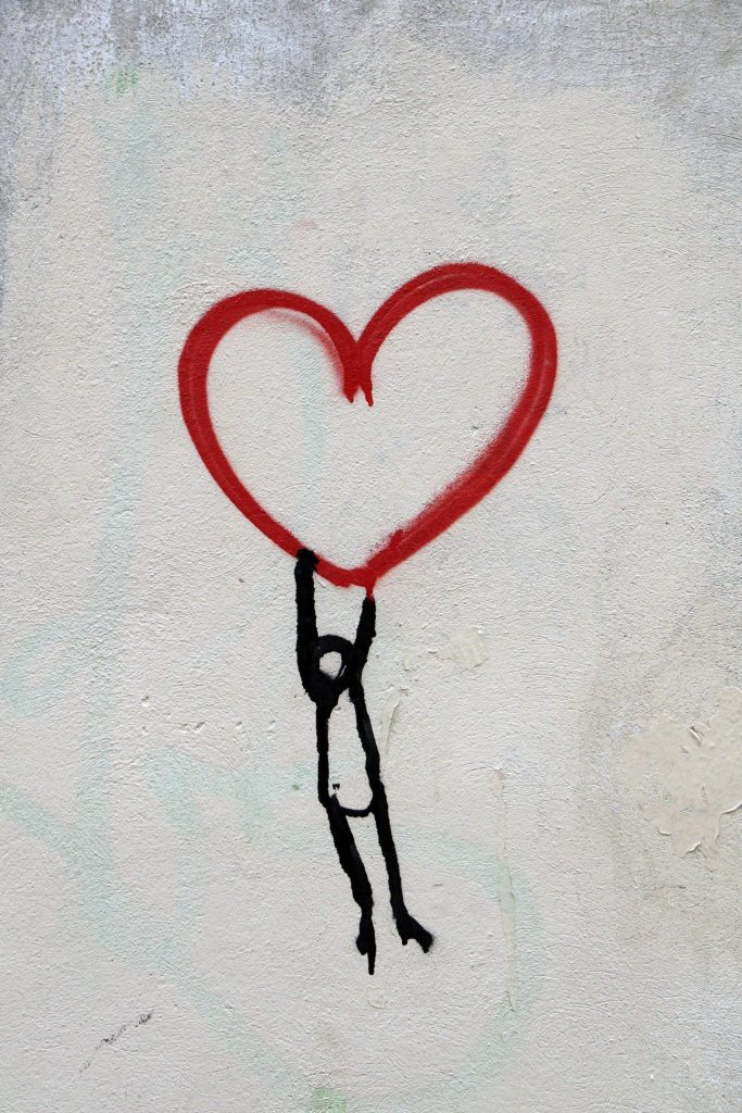 drawing of person holding to love