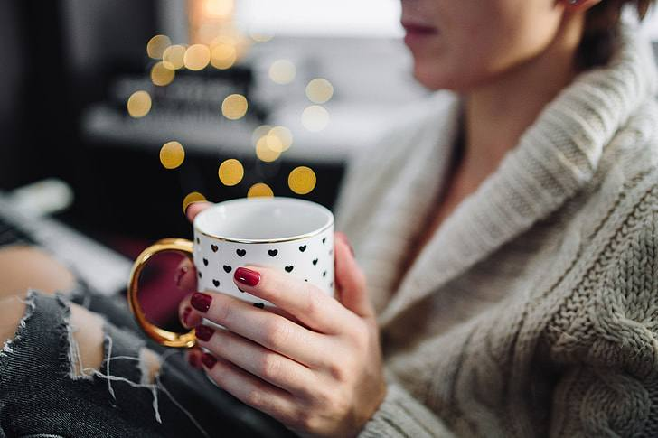 woman with tea relaxing alcohol and anxiety
