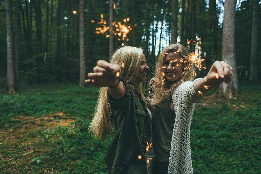 Two women celebrating in the forest - Having a good time without alcohol