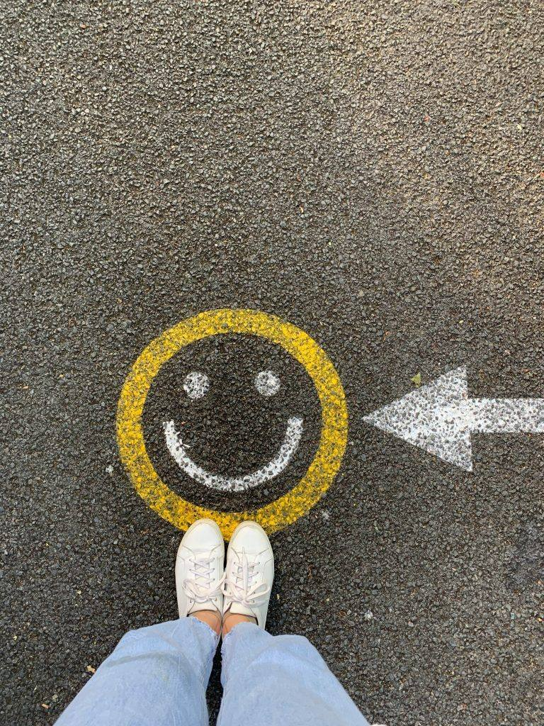 Smiley face at feet- Alcohol Deprivation Blues - Understanding and Managing the Dopamine Dip  in Early Sobriety