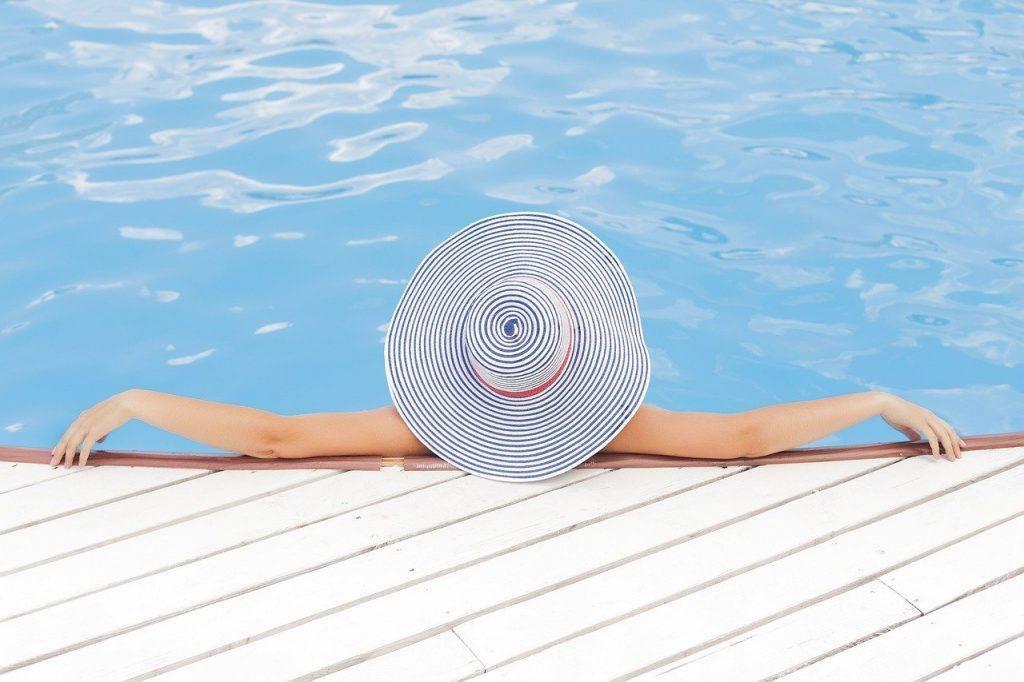 Woman at pool Dry July