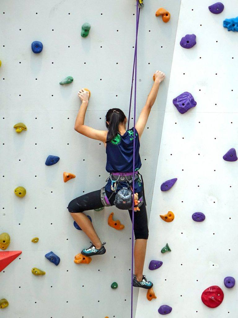 Woman Climbing to represent Going alcohol-free Day 7 dry july 2020 inspiration