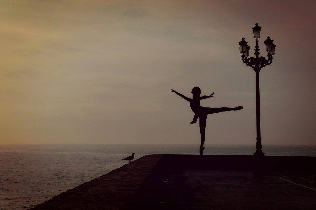 Woman ballet dancer alone on dock You Deserve Another Chance - A Sober Dance