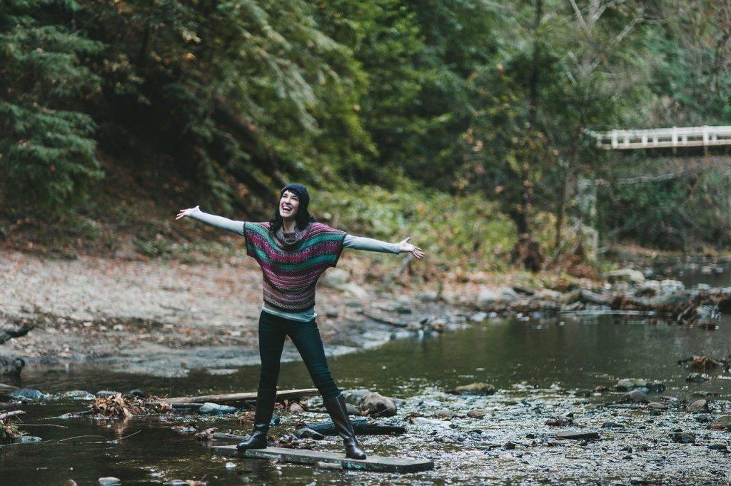 Joyful woman at river Living alcohol-free