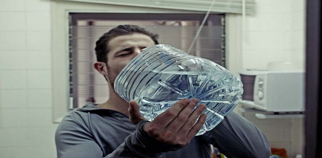 Man guzzling water - Play it forward to stay alcohol-free on Dayt 2 of Dry July 20202