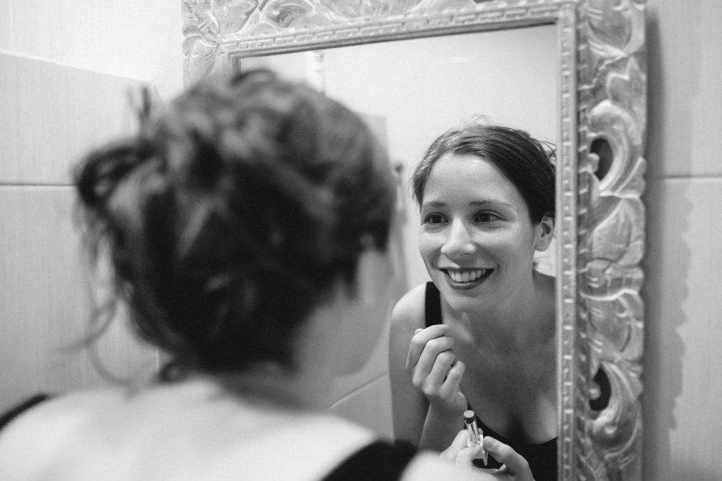 Woman looking in mirror- finding alternative to AA and loving myself sober
