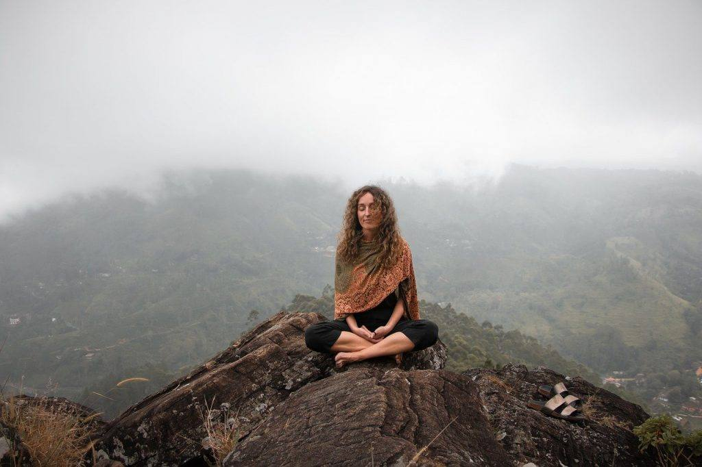 Woman meditating on Mountain top   to represent Going alcohol-free Day 7 dty july 2020 inspiration
