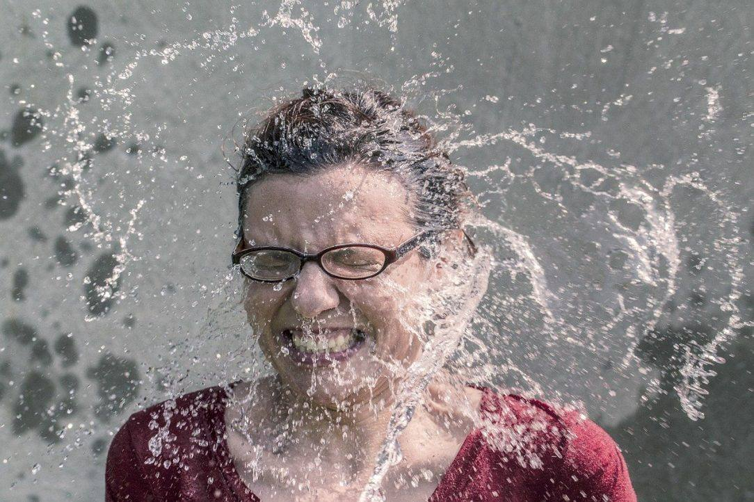 Happy Woman splashed with water Alcohol-Free Inspiration for Dry July 2020 - Day 3