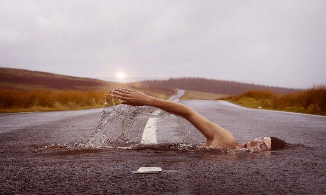 Man swimming on road Dry July 2929 day 10 alcohol free inspiration