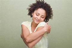 Woman hugging self - How do you stop drinking and stay sober with a partner who drinks