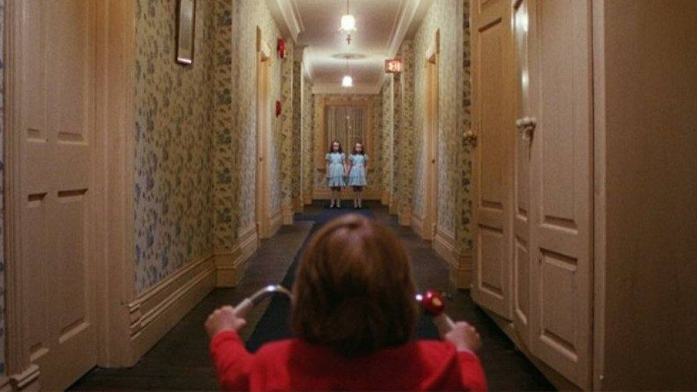 The Shining movie scene of little boy on scooter in hotel representing an alcoholics battle with his addiction