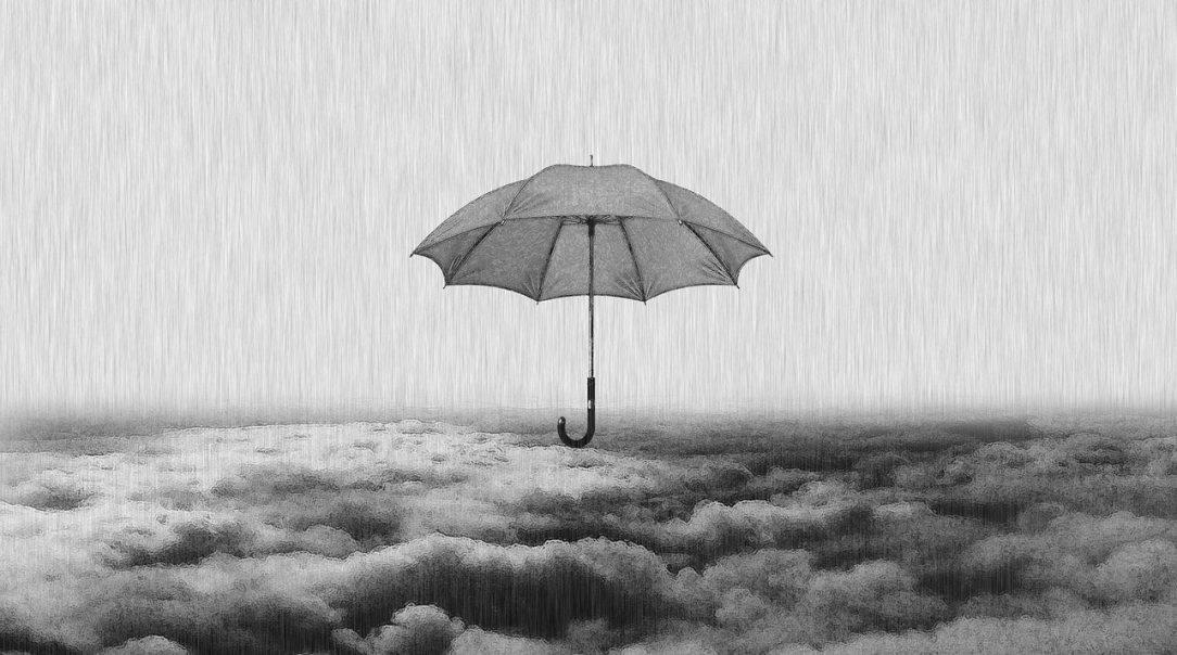 Umbrella in storm representing self discipline as self care at 6 months sober