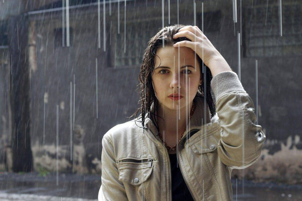 Woman in rain perspective on stop drinking alcohol