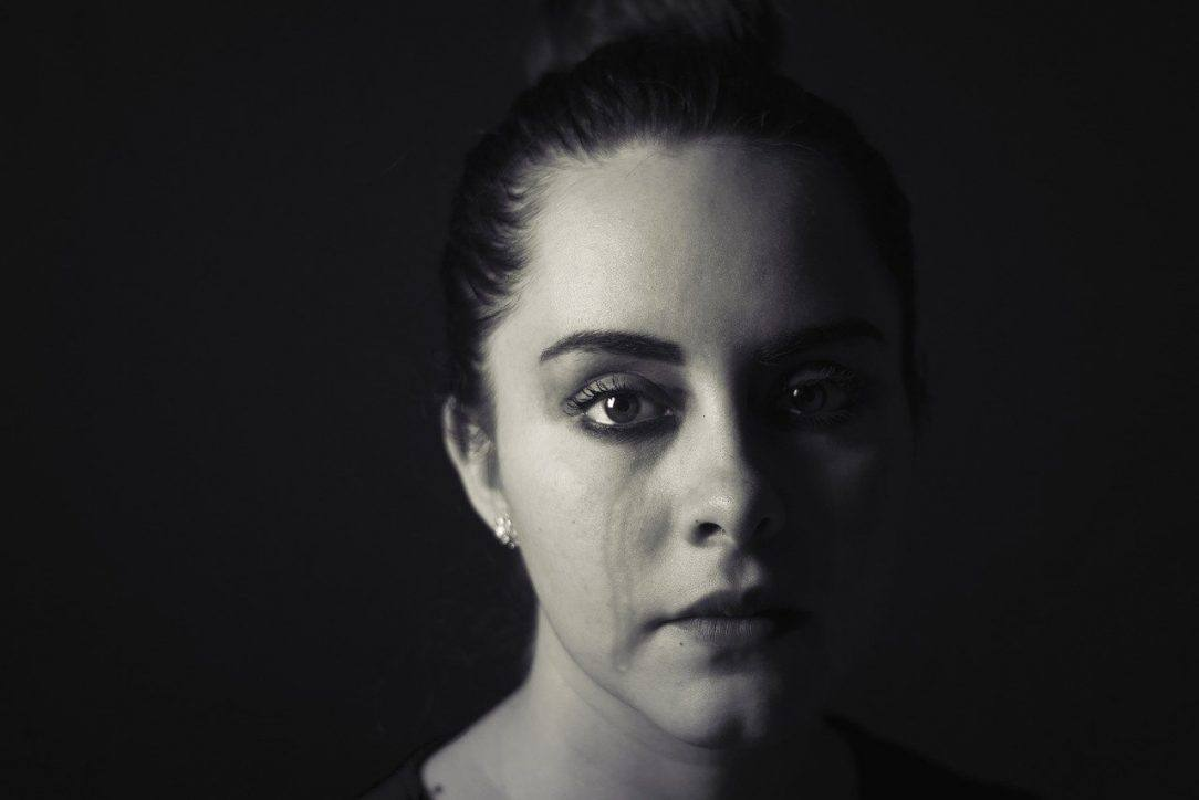 Woman crying How Drinking Too Much Alcohol Effects Your Looks