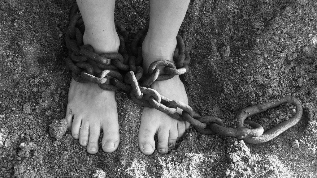 Feet chained - chained to alcohol addiction
