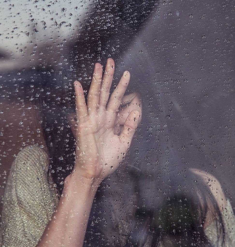 Woman at window with rain - My Sober Journey
