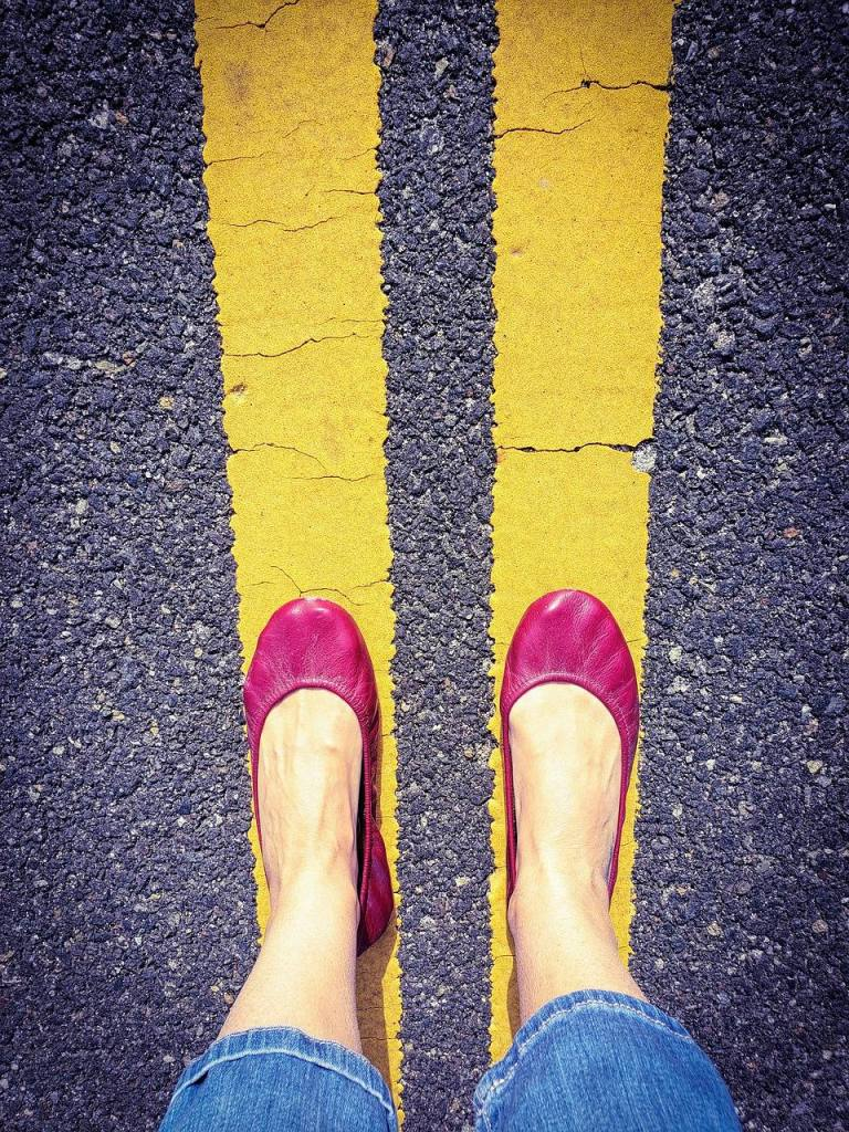 Pink shoes on road walking to stay sober after slips and relapse