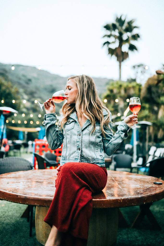 woman drinking wine myth of alcohol and beautiful life styles