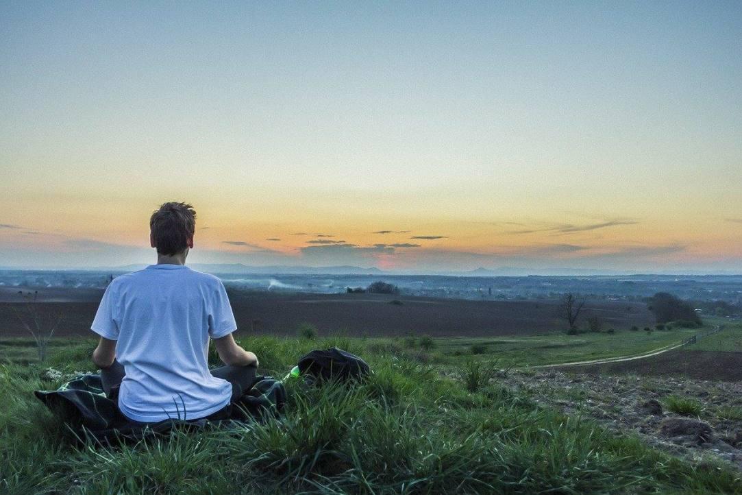 Man meditating sobriety