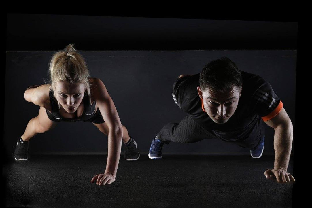 Man and woman doing pushups heroic tales of cutting the umbilical chord to the booze beast