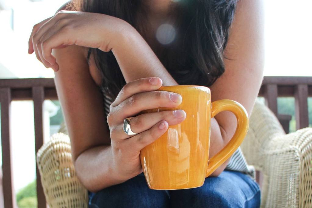 Woman with cup quit drinking