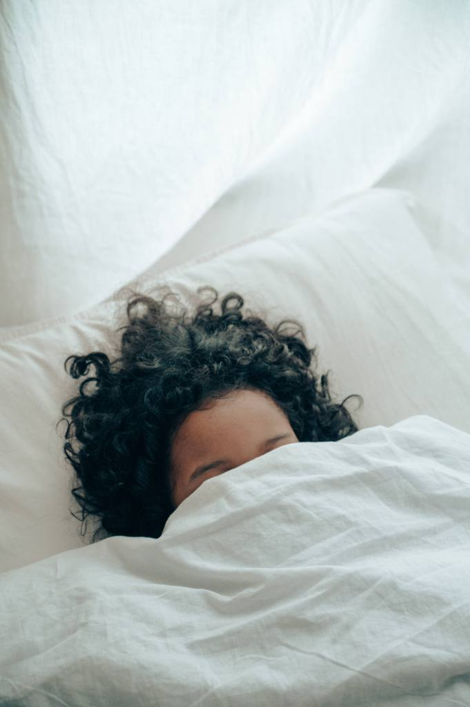 Woman hiding under covers one year sober