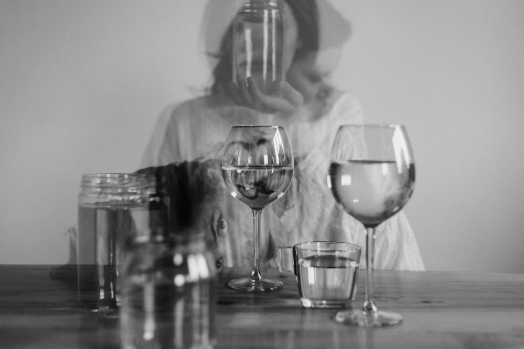 Woman looking through glass for Alcohol Awareness month