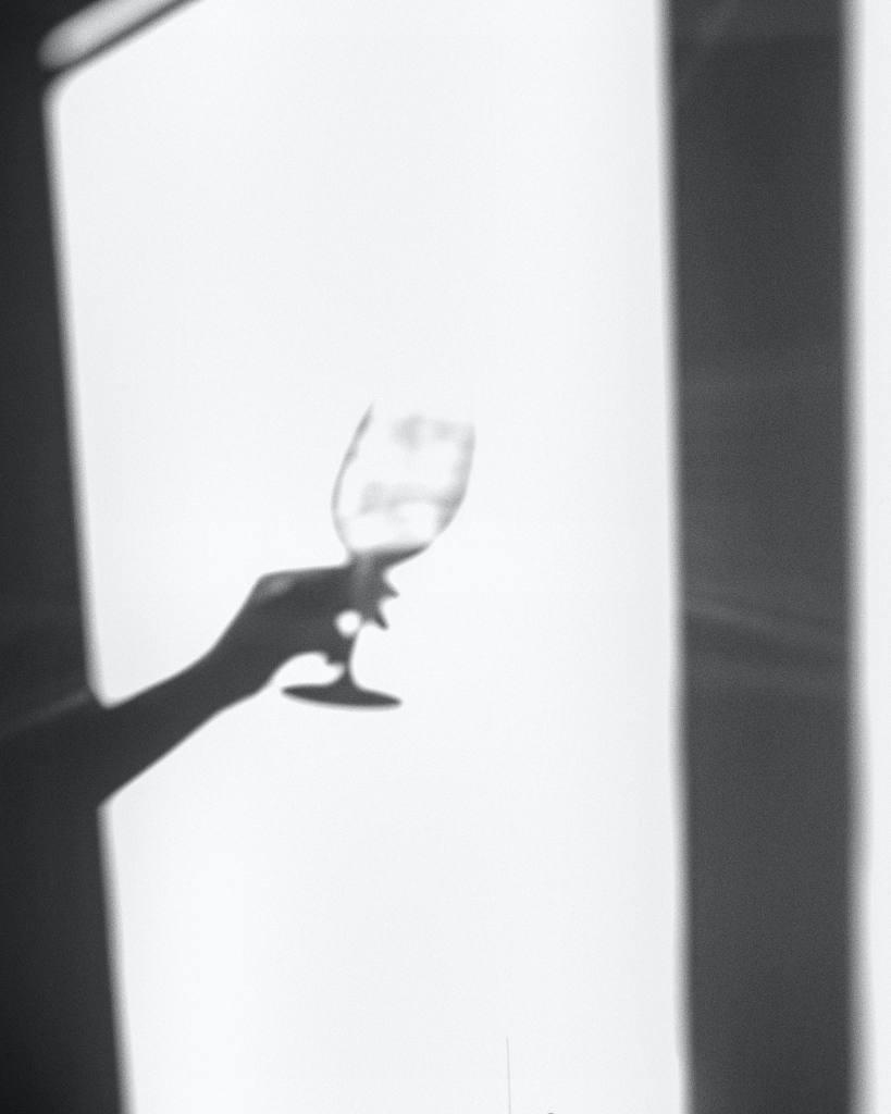 Wine glass in shadow hiding my drinking