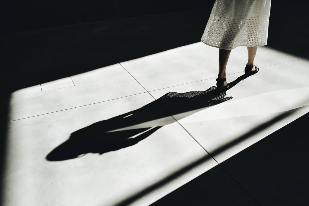 woman walking with shadow- looking back from 5 months sober