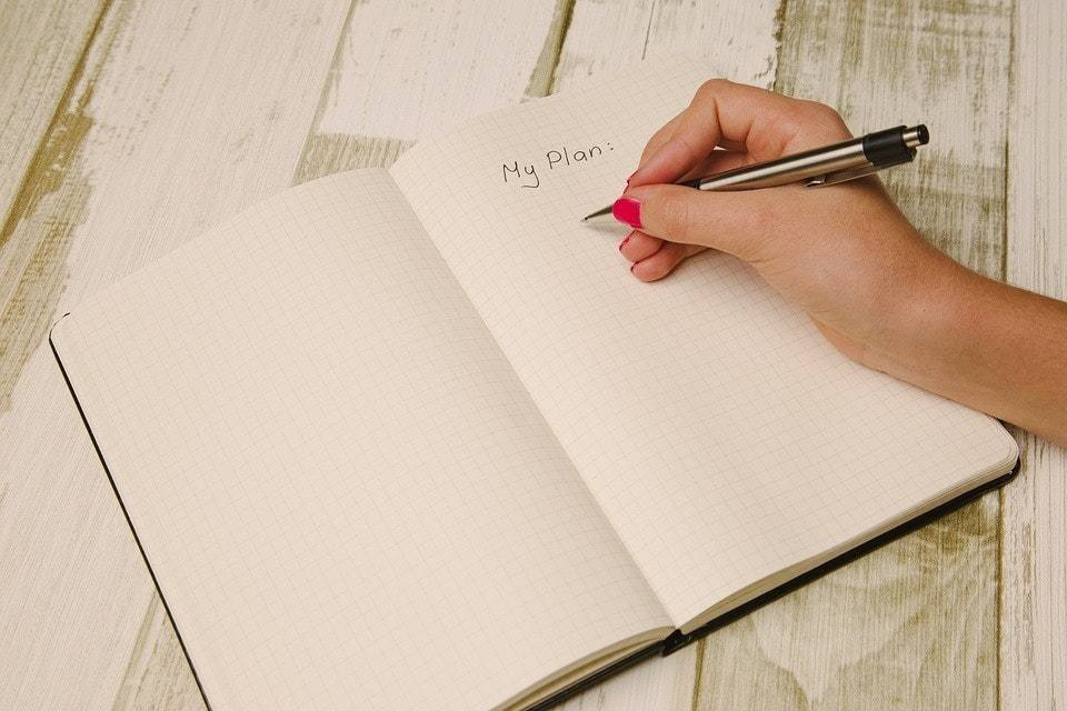 Woman writing in Journal - Uncovering the Secrets to Staying Sober