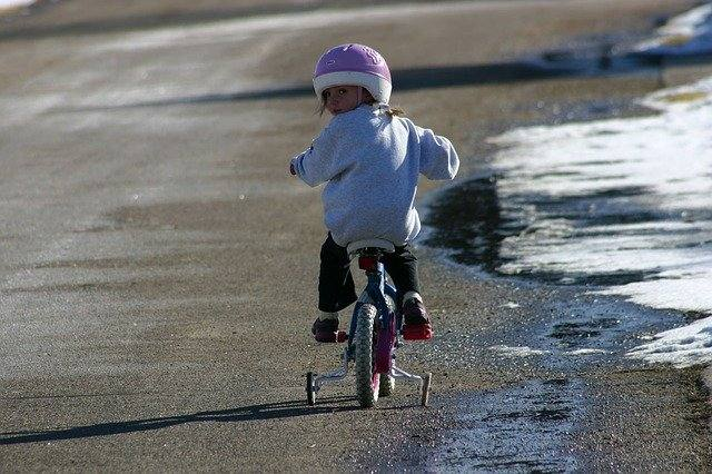 Child learning to ride bike